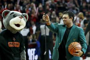 """Masters Champion Patrick Reed lines up the """"first shot"""" before Game 1 of an NBA basketball first-round playoff series between the Houston Rockets and the Minnesota Timberwolves at Toyota Center on Sunday, April 15, 2018, in Houston. ( Brett Coomer / Houston Chronicle )"""