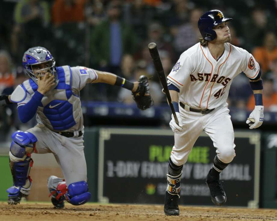 Houston Astros Josh Reddick singles on a soft ground ball to Texas Rangers pitcher Jake Diekman during the tenth inning of game at Minute Maid Park Sunday, April 15, 2018, in Houston. ( Melissa Phillip / Houston Chronicle ) Photo: Melissa Phillip/Houston Chronicle