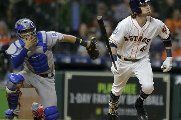Houston Astros Josh Reddick singles on a soft ground ball to Texas Rangers pitcher Jake Diekman during the tenth inning of game at Minute Maid Park Sunday, April 15, 2018, in Houston. ( Melissa Phillip / Houston Chronicle )