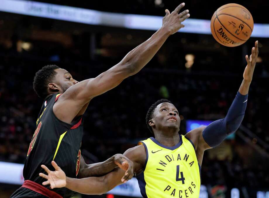 Cleveland Cavaliers' Jeff Green, left, and Indiana Pacers' Victor Oladipo (4) battle for a rebound in the first half of Game 1 of an NBA basketball first-round playoff series Sunday, April 15, 2018, in Cleveland. (AP Photo/Tony Dejak) Photo: Tony Dejak / AP 2018