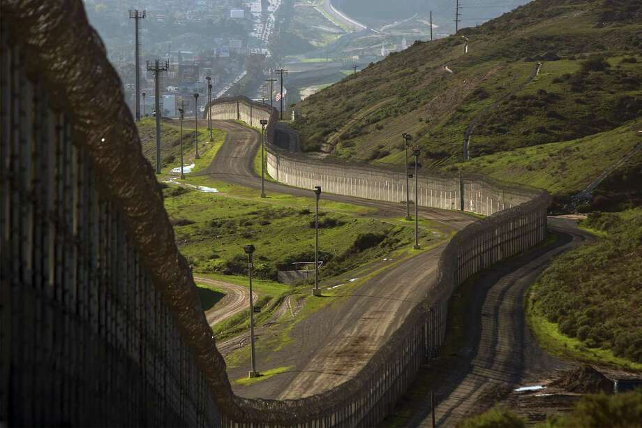 Multiple layers of steel walls, fences, razor wire and other barricades are viewed from the United States side of the U.S.-Mexico border in San Ysidro, Calif. Photo: DAVID MCNEW, Stringer / AFP/Getty Images / AFP or licensors