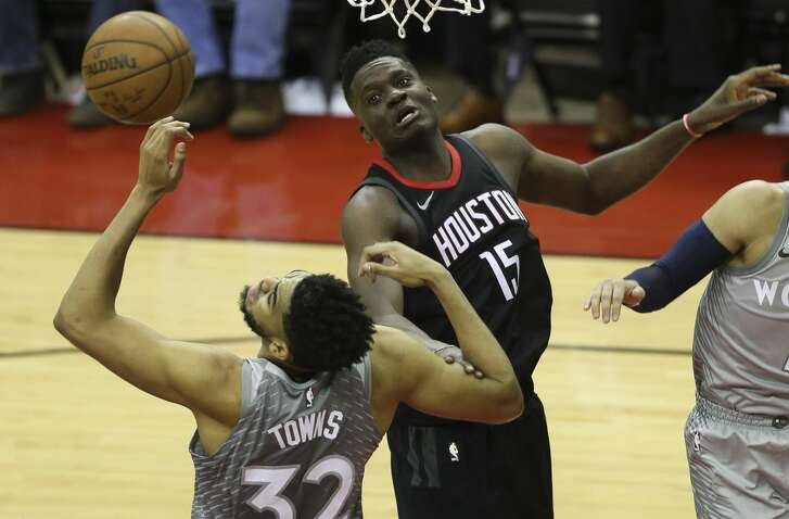 Houston Rockets center Clint Capela (15) and Minnesota Timberwolves center Karl-Anthony Towns (32) have their eyes on a loose ball during the third quarter of Game 1 of an NBA basketball first-round playoff series at Toyota Center on Sunday, April 15, 2018, in Houston. ( Yi-Chin Lee / Houston Chronicle )
