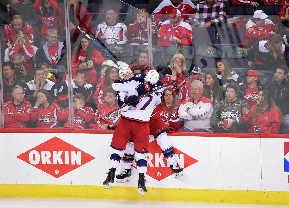 Columbus Blue Jackets left wing Matt Calvert (11) celebrates his game-winning goal with center Brandon Dubinsky (17) in overtime in Game 2 of an NHL first-round hockey playoff series against the Washington Capitals, Sunday, April 15, 2018, in Washington. The Blue Jackets won 4-3 in overtime. (AP Photo/Nick Wass) Photo: Nick Wass / FR67404 AP
