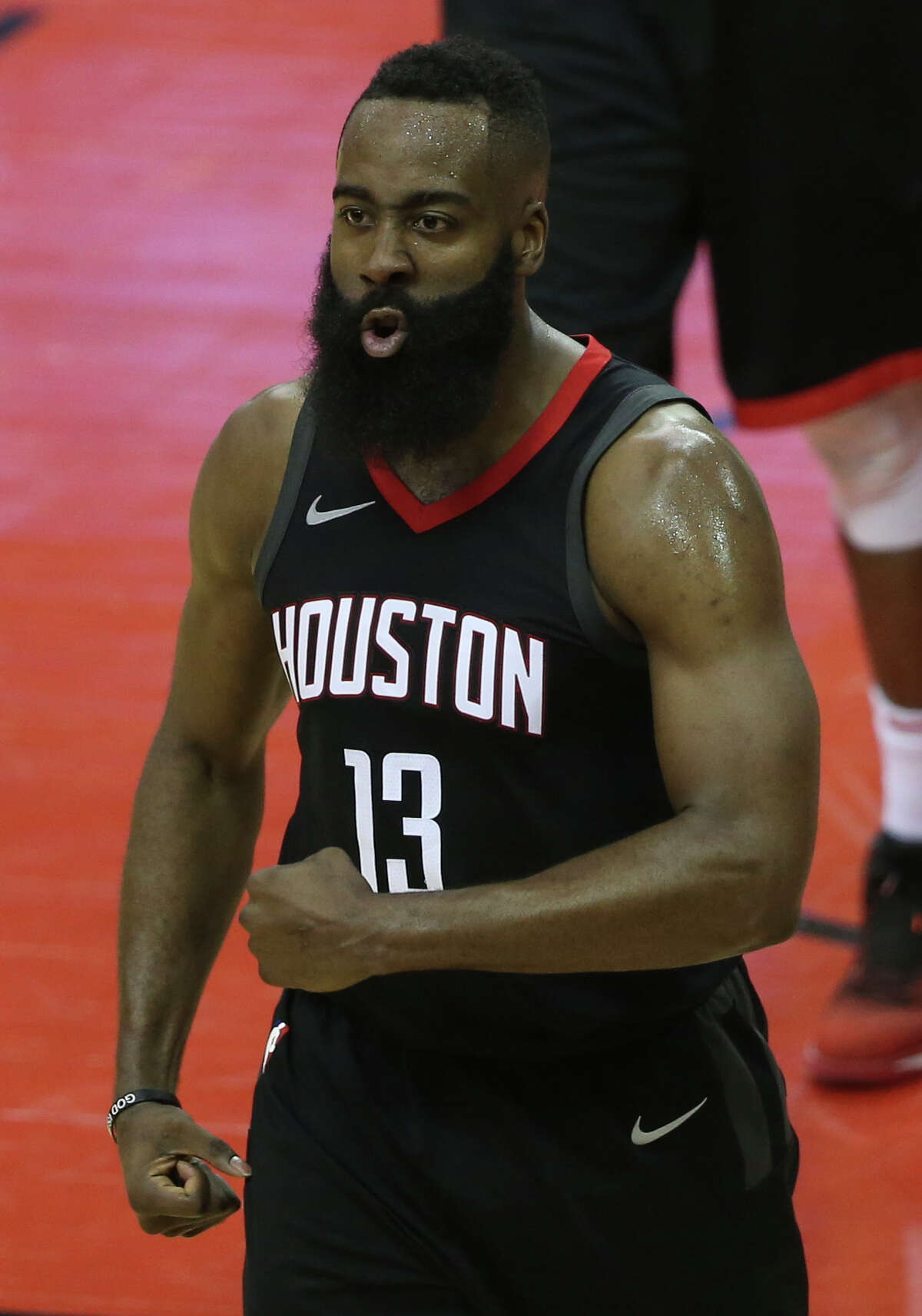 Houston Rockets guard James Harden (13) cheers for himself before going on the line for two free throws after being fouled by Minnesota Timberwolves center Gorgui Dieng (5) during the third quarter of Game 1 of an NBA basketball first-round playoff series at Toyota Center on Sunday, April 15, 2018, in Houston. ( Yi-Chin Lee / Houston Chronicle )