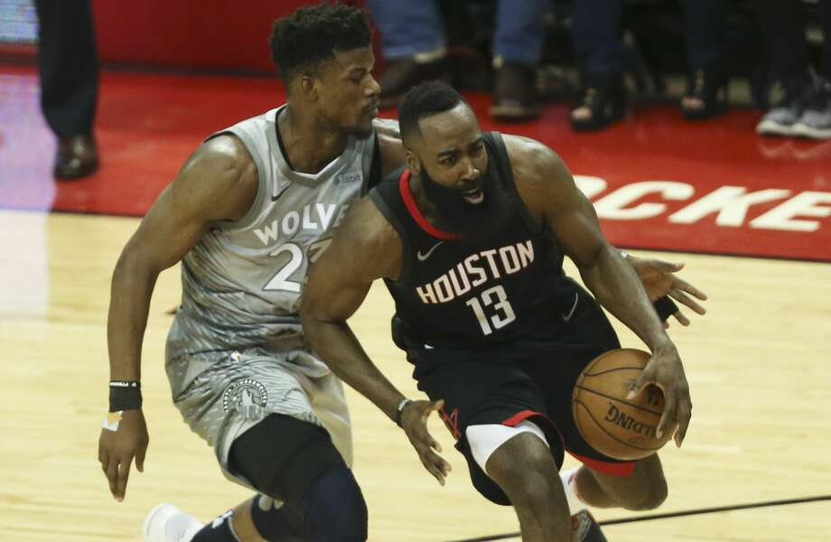 Minnesota Timberwolves guard Jimmy Butler (23) tries to strip the ball from Houston Rockets guard James Harden (13) during the fourth quarter of Game 1 of an NBA basketball first-round playoff series at Toyota Center on Sunday, April 15, 2018, in Houston. ( Yi-Chin Lee / Houston Chronicle ) Photo: Yi-Chin Lee/Houston Chronicle