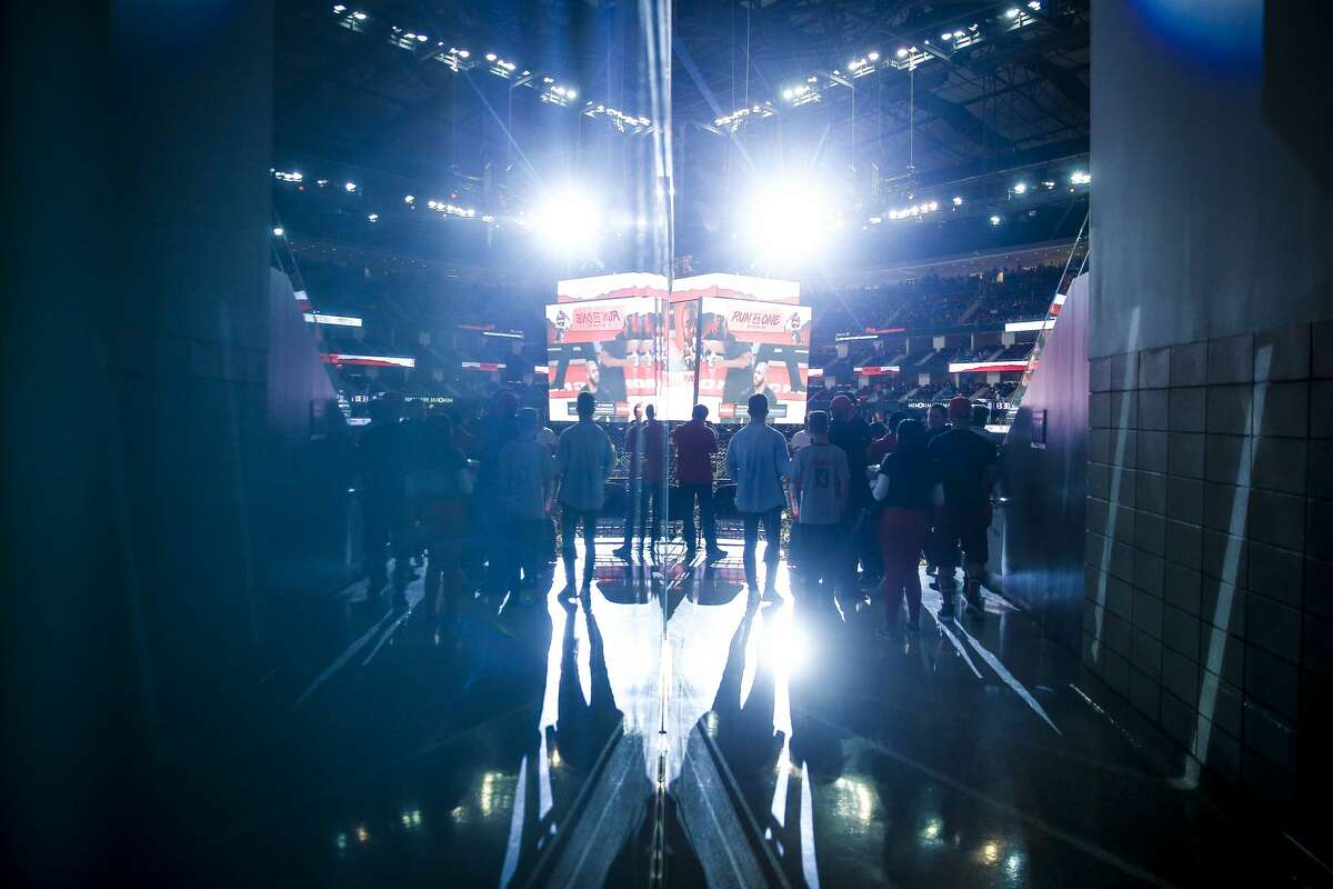 Fans walk to their seats as they arrive at the Toyota Center as the Houston Rockets take on the Minnesota Timberwolves in the first game of the NBA playoffs Sunday, April 15, 2018 in Houston. (Michael Ciaglo / Houston Chronicle)