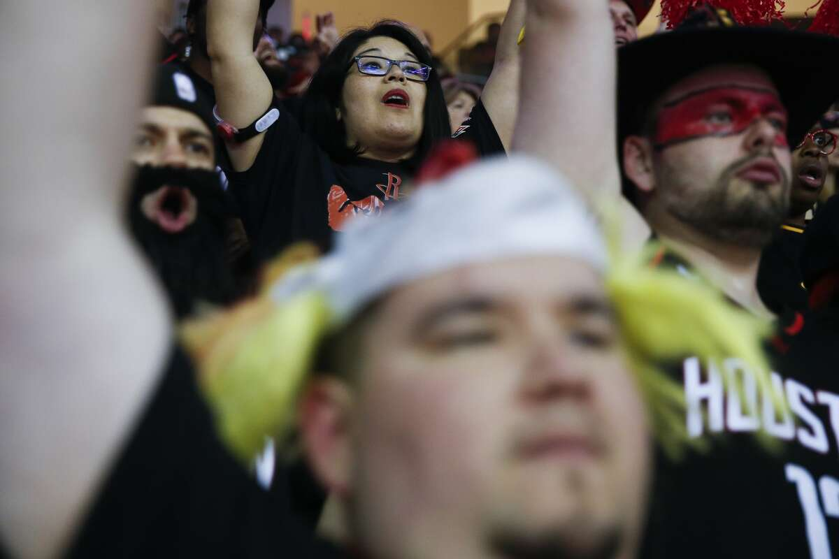 Natalie Morales, top center, throws her hands up as she waits to see if a shot connects as the Houston Rockets take on the Minnesota Timberwolves in the first game of the NBA playoffs at the Toyota Center Sunday, April 15, 2018 in Houston. (Michael Ciaglo / Houston Chronicle)
