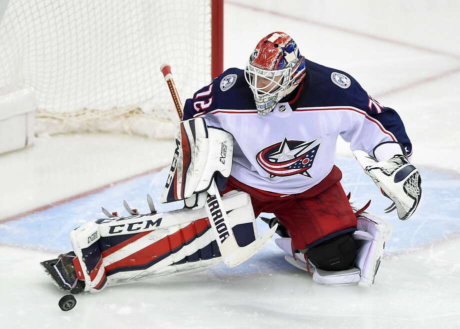 Columbus goalie Sergei Bobrovsky makes one of his 54 saves in an overtime victory over Washington. Photo: Nick Wass / Associated Press