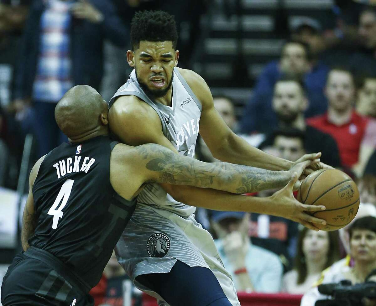 Houston Rockets forward PJ Tucker (4) reaches in to knock the ball away from Minnesota Timberwolves center Karl-Anthony Towns (32) during the second quarter of Game 1 of an NBA basketball first-round playoff series at Toyota Center on Sunday, April 15, 2018, in Houston. ( Brett Coomer / Houston Chronicle )