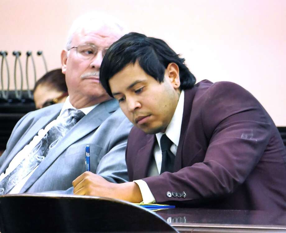 Michael Molina takes notes as he waits for a witness to testify in his murder trial last week. Photo: Cuate Santos /Laredo Morning Times / Laredo Morning Times