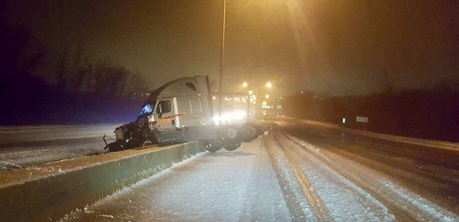 Slick conditions led to a jackknifed tractor-trailer accident on I-91 in Windsor on Monday, April 16, 2018. Areas of northern Connecticut has sleet and freezing rain, while the southern portion of the state saw rain. Photo: State Police Photo