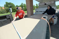 Pastor Tony Wilcoxson helps Vidor's Gabby Ramos load sheet rock and other rebuilding materials after a fresh shipment of donations arrived at Rose City Baptist Church. While the church is still in its own state of recovery on both the sanctuary, education center and offices, they have maintained their role in helping others affected by Harvey's devastating floods. The church got their eighth delivery from the Missouri faith-based non-profit group Convoy of Hope. Each shipment contains 1000 sheets of sheet rock, loads of insulation and other materials. Wilcoxson says this load will likely be all gone within a few days.   Photo taken Wednesday, April 11, 2018 Kim Brent/The Enterprise