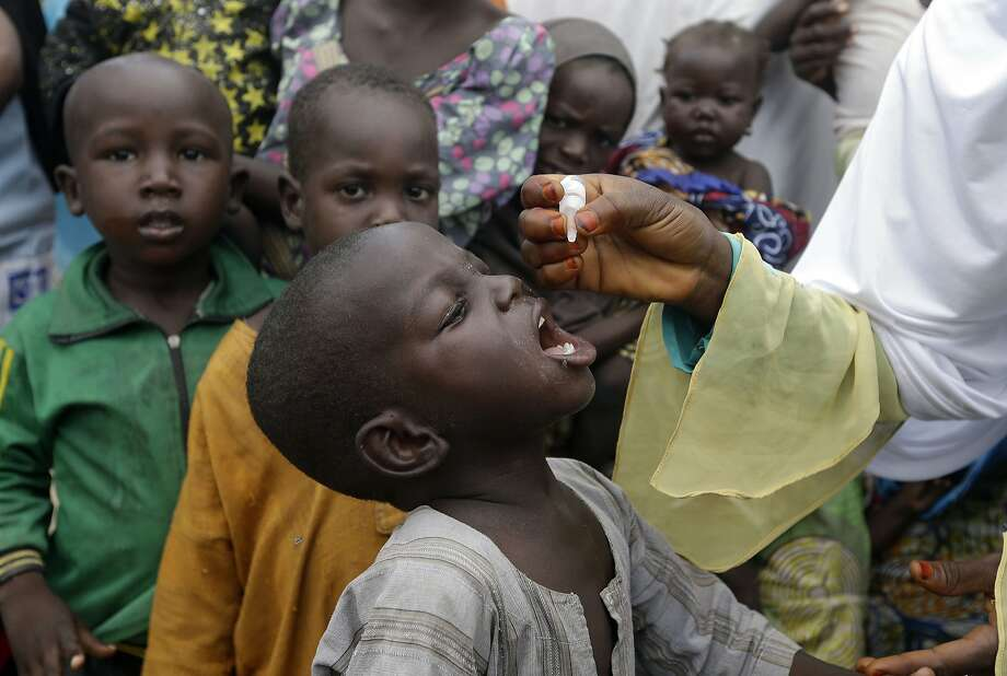 A child receives a polio vaccine last year at a camp for people displaced by militants in Maiduguri, Nigeria. Photo: Sunday Alamba / Associated Press 2016