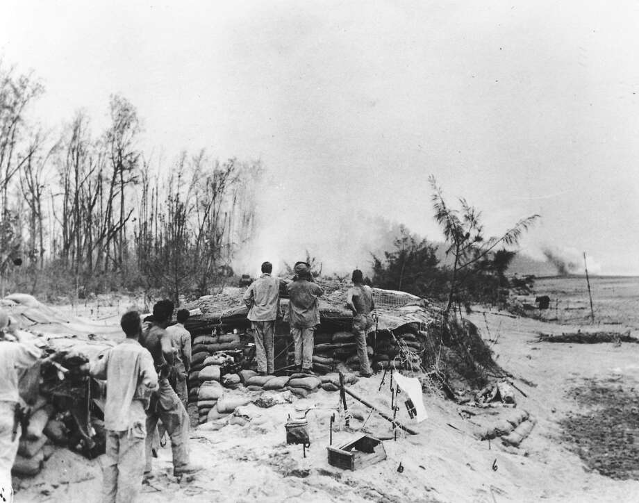 A 1944 photo shows U.S. troops on Bougainville in Papua New Guinea where Admiral Isoroku Yamamoto was killed. Photo: Associated Press 1944