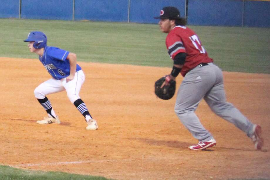 Shepherd Pirate Travis Boone (left) leads off of first base in the April 10 baseball game against the Diboll Lumberjacks. Photo: Jacob McAdams / Jacob McAdams
