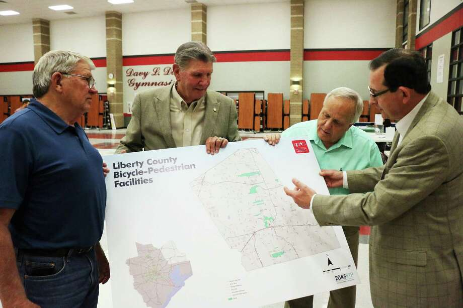 Pct. 2 Commissioner Greg Arthur, former county judge Lloyd Tookie Kirkham, and County Judge Jay Knight listen as HGACs Alan Clark shows proposed bicycle-pedestrian facilities for Liberty County in the 2045 Regional Transportation Plan. Photo: David Taylor / David Taylor