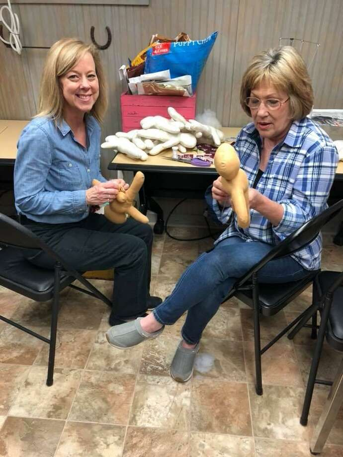 """Carri Cronin (left) and Verna """"Bunny"""" Irwin work on creating medical help dolls for use at Texas Children's Hospital in the Woodlands. The dolls were delivered on April 11. Photo: Submitted / Submitted"""