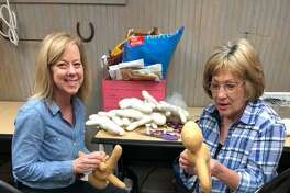 "Carri Cronin (left) and Verna ""Bunny"" Irwin work on creating medical help dolls for use at Texas Children's Hospital in the Woodlands. The dolls were delivered on April 11."