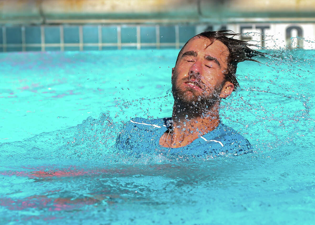Steve Johnson jumps into the pool, a tradition, after winning the U.S. Men?'s Clay Court Championship at River Oaks Country Club on Sunday, April 15, 2018, in Houston. Johnson defeated Tennys Sandgren for his second title back-to-back 7-6, 2-6 and 6-4.