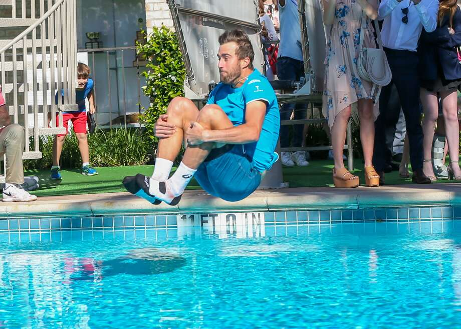 Steve Johnson jumps in the pool in celebration of his win, beating Tennys Sandgren, during the Men's Clay Court Championship match on April 15, 2018, at River Oaks Country Club in Houston. Photo: Icon Sportswire/Icon Sportswire Via Getty Images