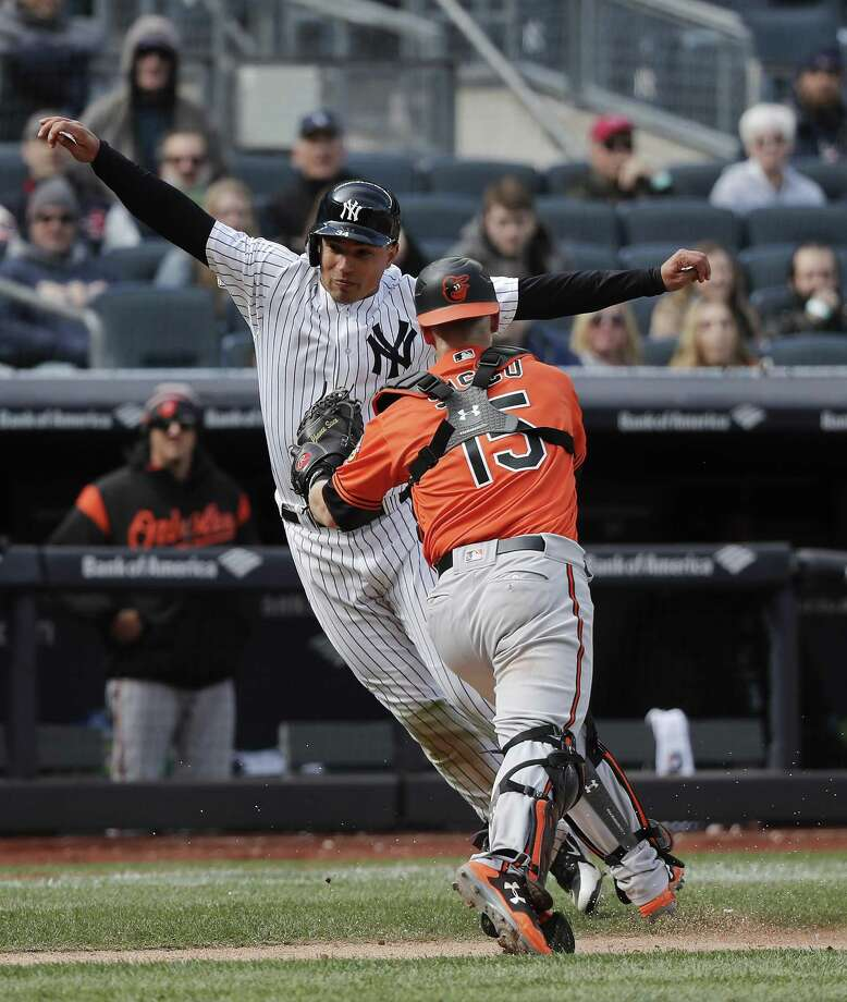 New York Yankees' Jace Peterson is tagged out by Baltimore Orioles catcher Chance Sisco (15) while caught in a rundown between third base and home plate during the eighth inning of a baseball game, Saturday, April 7, 2018, in New York. The Yankees won 8-3. (AP Photo/Julie Jacobson) Photo: Julie Jacobson, STF / Associated Press / Copyright 2018 The Associated Press. All rights reserved.