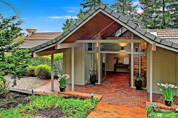 Waterfront NW Contemporary on Mercer Island offers timeless modern beauty in a sylvan setting.