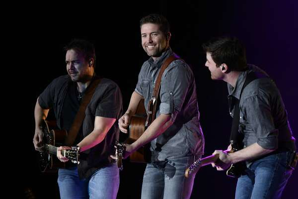 """Country music artist Josh Turner performs during the annual """"Big Boys Toys"""" fundraiser for MARC, a local organization delivering programs to individuals with intellectual, developmental, and cognitive disabilities April 14, 2018 at Horseshoe Pavillion. The event featured a high end car show, silent and live auctions, and concert from Josh Turner. CREDIT: James Durbin / TheOilfieldPhotographer.com"""