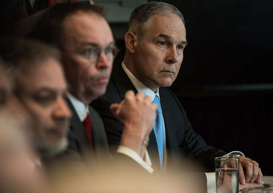 "Environmental Protection Agency (EPA) administrator Scott Pruitt listens to US President Donald Trump speak during a cabinet meeting at the White House in Washington, DC, on April 9, 2018. President Donald Trump said Monday that ""major decisions"" would be made on a Syria response in the next day or two, after warning that Damascus would have a ""big price to pay"" over an alleged chemical attack on a rebel-held town.Trump condemned what he called a ""heinous attack on innocent"" Syrians in Douma, as he opened a cabinet meeting at the White House.   / AFP PHOTO / NICHOLAS KAMMNICHOLAS KAMM/AFP/Getty Images Photo: NICHOLAS KAMM;Nicholas Kamm / AFP / Getty Images"
