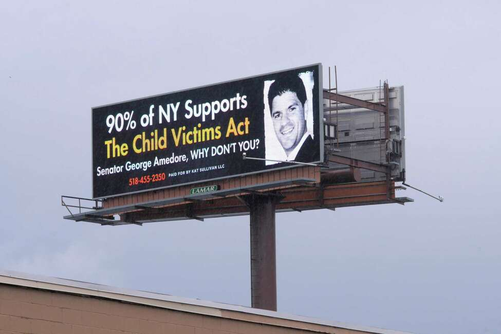 A view of a billboard with a message paid for by Kat Sullivan, a survivor of child sex abuse, seen here on Monday, April 16, 2018, in Albany, N.Y. The billboard, seen in the background, is located along Interstate 787. (Paul Buckowski/Times Union)
