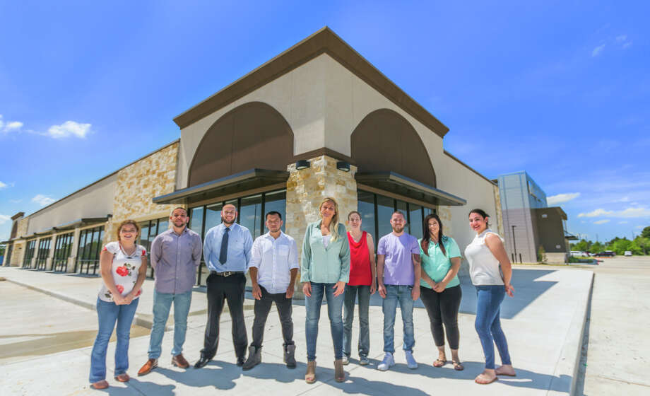 Brittney Aplin, center, is shown with the team for the new Captain Brad's Coastal Kitchen. From left, Abigail Martinez, Marcial Carbonell, Leo Ponce, Joel Flores, Brittney, Sarah Yeley, Scott Ensign, Lea Ponce and Jennifer Tamez. Photo: Captain Brad's Coastal Kitchen