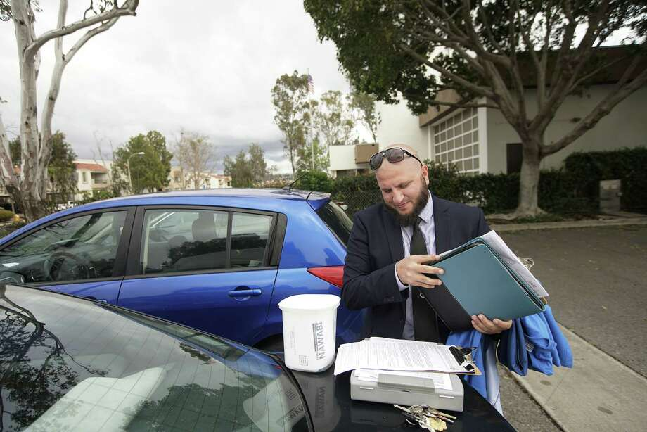 Fayaz Nawabi, a Muslim candidate running for San Diego City Council, gathers his belongings before going to a debate at the Mira Mesa Public Library in San Diego on March 3, 2018. Photo: Photo For The Washington Post By Sandy Huffaker / 2018 Sandy Huffaker