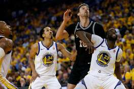 San Antonio Spurs center Pau Gasol (16) looks for the rebound against Golden State Warriors guard Shaun Livingston (34) and forward Draymond Green (23) during the fourth quarter of Round 1 Game 1 of the NBA Western Conference Finals between the Spurs and Golden State Warriors at Oracle Arena, Saturday, April 14, 2018, in Oakland, Calif. The Spurs lost 92-113.