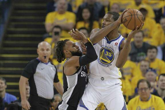 The Warriors' Kevin Durant found himself in some mismatches against the Spurs' Patty Mills during Game 1 of the series.