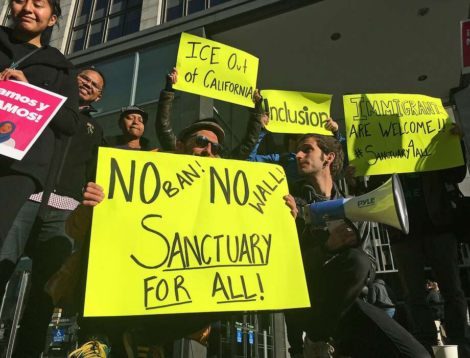 Protesters outside the federal courthouse in San Francisco a year ago, when a judge heard arguments in the first lawsuit challenging President Trump's order to withhold funding from communities that limit cooperation with immigration authorities. Photo: Haven Daley / Associated Press