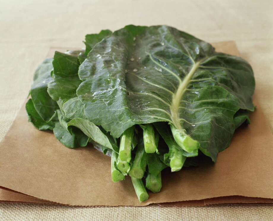 Family Collard Greens combines greens with the meat from smoked turkey legs. Photo: Jennifer Levy /Getty Images / &#169 Jennifer Levy/FoodPix