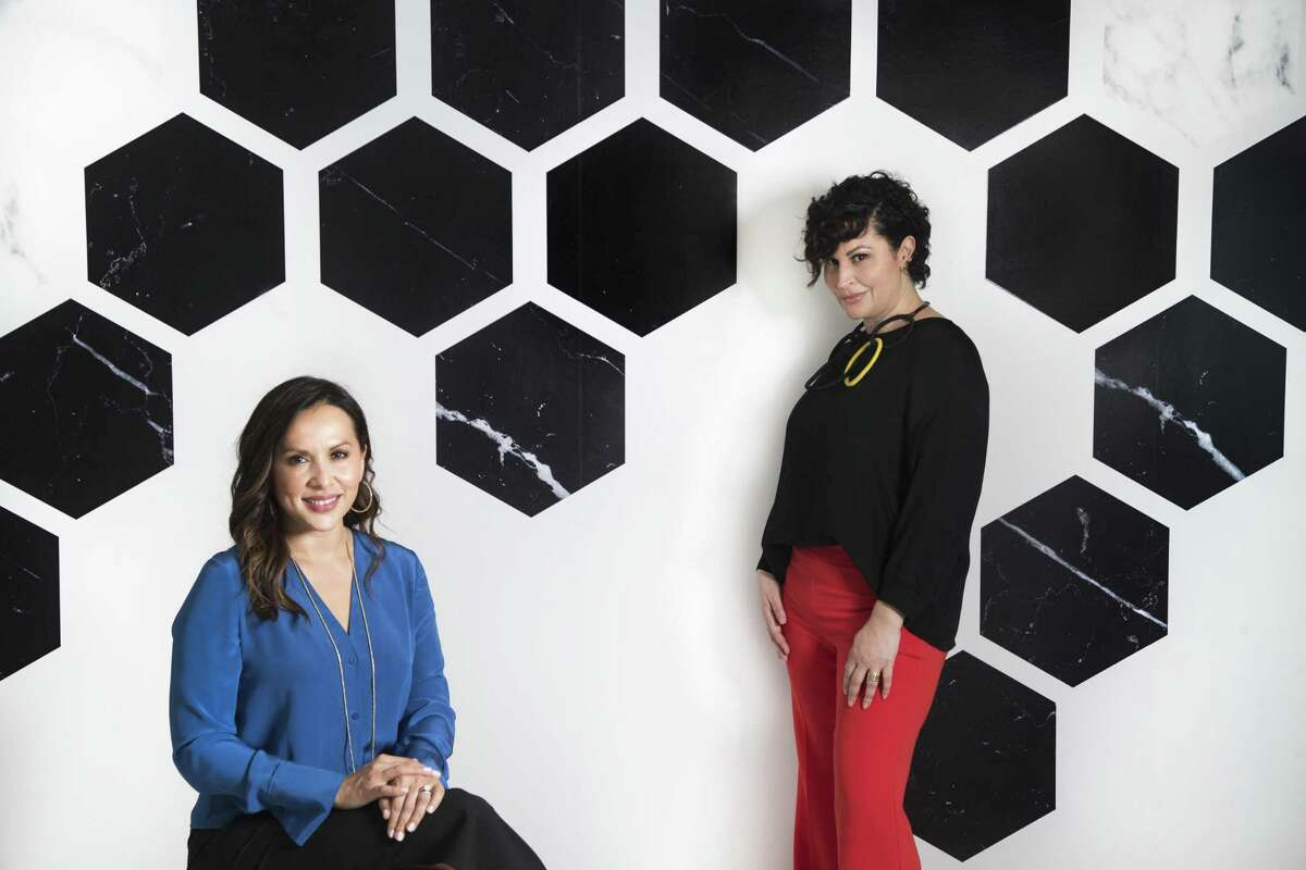 Olivia + Poppy creative director, Tina Silvestri, right, and Jamie Graney, CEO and founder of Olivia + Poppy wallpaper company.