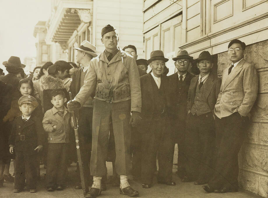 Dorothea Lange's photograph of San Francisco's Japantown, shortly after Executive Order 9066 was signed. These Japanese Americans would be relocated within three days. Photo: Courtesy Of Swann Auction Galleries