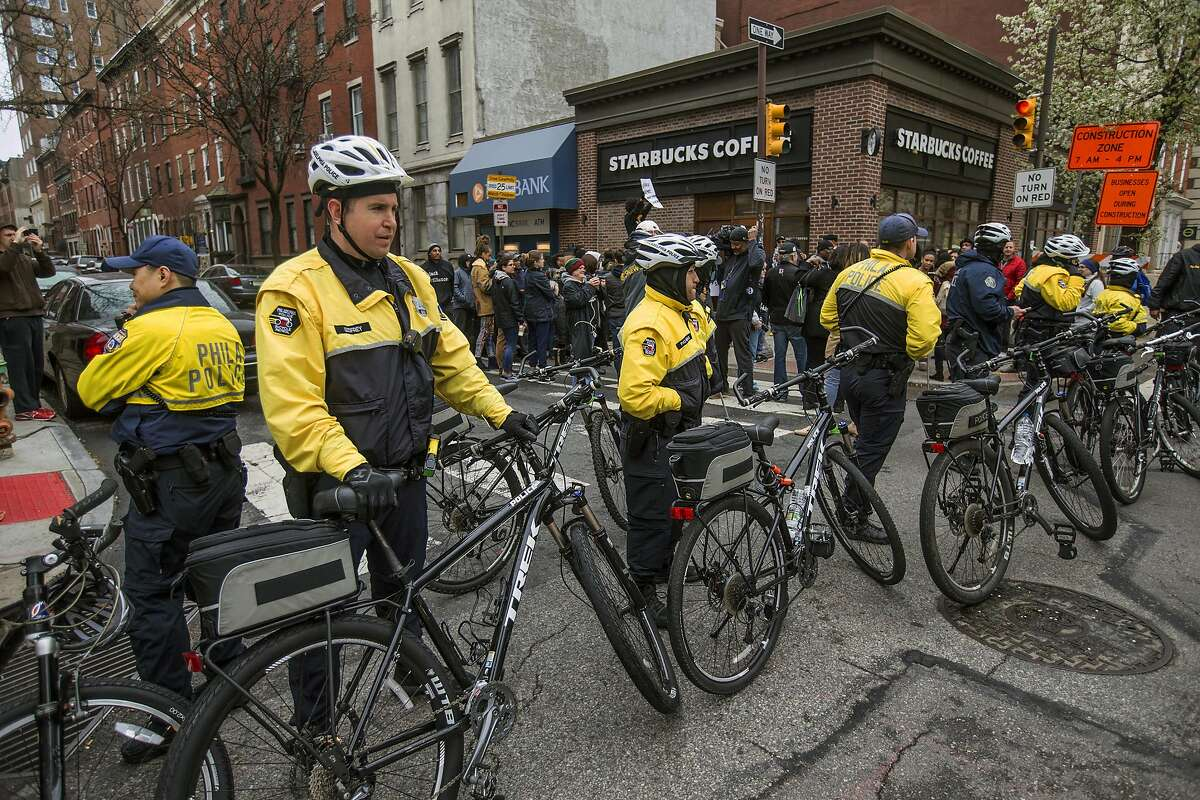 Philadelphia police form a line in front of the Starbucks that was at the center of a Black Lives Matter protest on Sunday, April 15, 2018. Two black men were arrested Thursday after Starbucks employees called police to say the men were trespassing. The arrest prompted accusations of racism on social media. Starbucks CEO Kevin Johnson posted a lengthy statement Saturday night, calling the situation