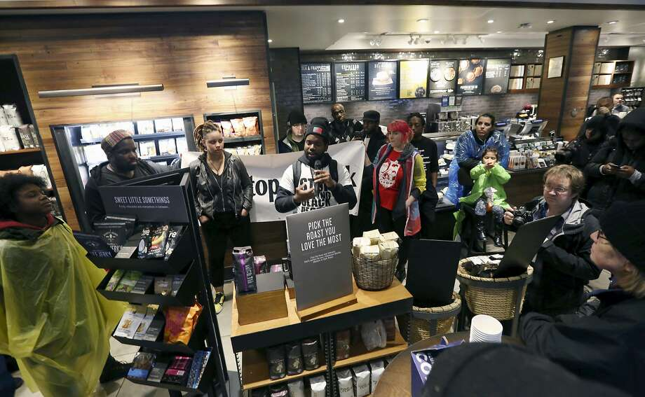 Protesters occupy the Starbucks location in Philadelphia where two black men were arrested for trespassing last week. Photo: Jacqueline Larma / Associated Press