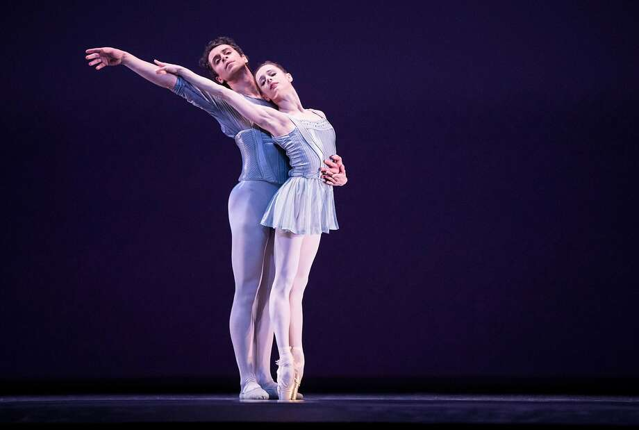 "Principal dancers Maria Kochetkova (right) and Vitor Lutz perform ""On a Theme of Paganini"" during a dress rehearsal of San Francisco Ballet's Program 3 at War Memorial Opera House in San Francisco, Calif., on Thursday, February 15, 2018. The ballet, choreographed by San Francisco Ballet Artistic Director Helgi Tomasson, is one of three ballets in the program. Photo: Laura Morton / Special To The Chronicle"