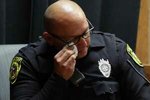 Bexar County Sheriff Deputy Louis Estrada wipes away tears after viewing crime scene photos that he was called to involving Deandre Dorch. Dorch is accused of injury to a child-serious bodily injury, in the horrific child abuse case involving two children who were found surrounded by their own feces and bound like dogs in a backyard of the Camelot II subdivision in Northeast Bexar County. The trial started on Monday, April 16, 2018 in the Felony Impact Court in the Bexar County Courthouse.