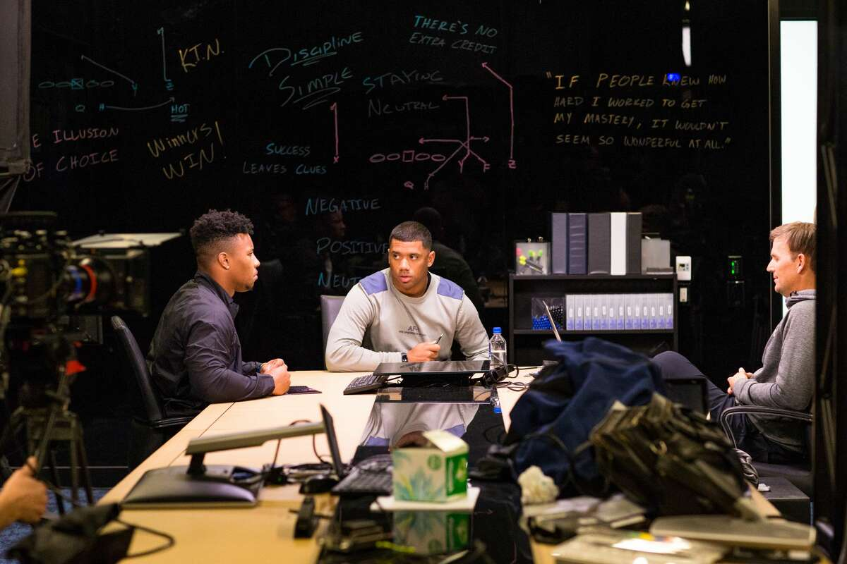 Russell Wilson of the Seattle Seahawks mentors former Penn State running back Saquon Barkley during a 2018 'QB2QB' segment.