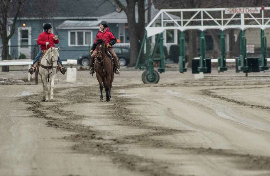 Outriders Lance Cronk, left and Roger Stockton have only themselves to watch out for on opening day of the Oklahoma Training Center adjacent to the Saratoga Race Course Monday April 16, 2018 in Saratoga Springs, N.Y. There were no trainees on the track this morning with only a few horse having arrived from Ocala the morning before.  (Skip Dickstein/Times Union) Photo: SKIP DICKSTEIN, Albany Times Union / 20043506A