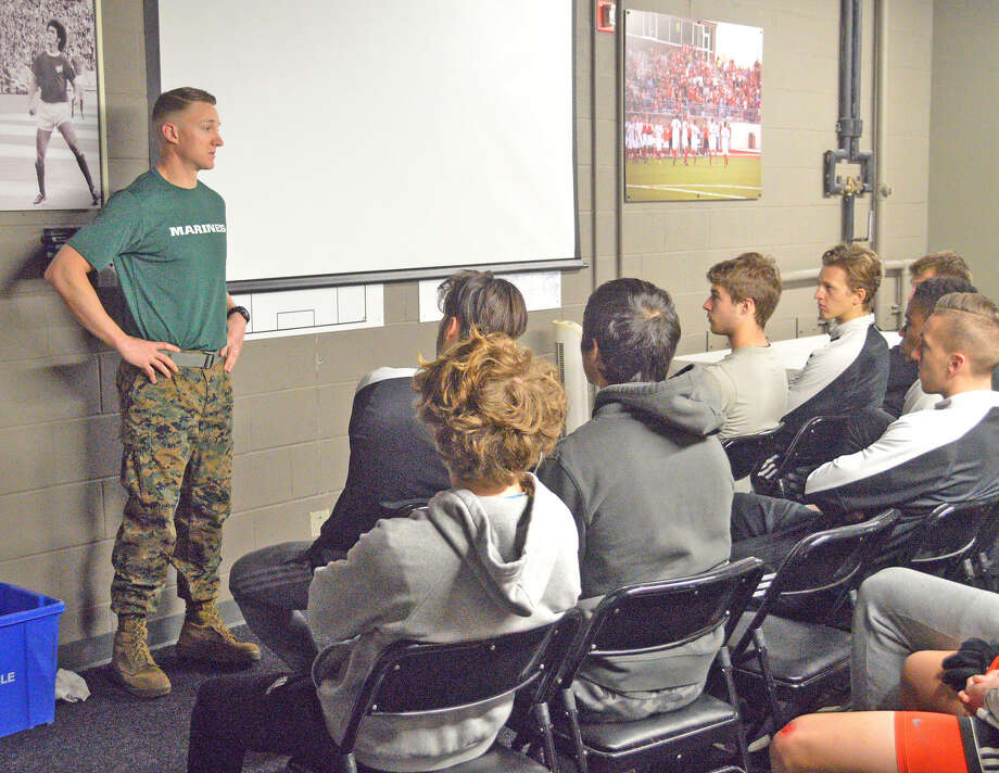 Edwardsville native Tom Pinnell, captain in the U.S. Marine Corps, conducts a leadership discussion with the SIUE men's soccer team on April 10 at Korte Stadium.
