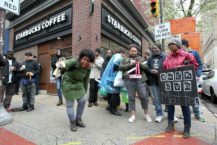 Protestor Aurica Hurst, from West Philadelphia, pours out coffee in front of Starbucks at 18th and Spruce Streets on Monday, April 16, 2018 in Philadelphia, Pa. Photo: JESSICA GRIFFIN /TNS / Philadelphia Inquirer