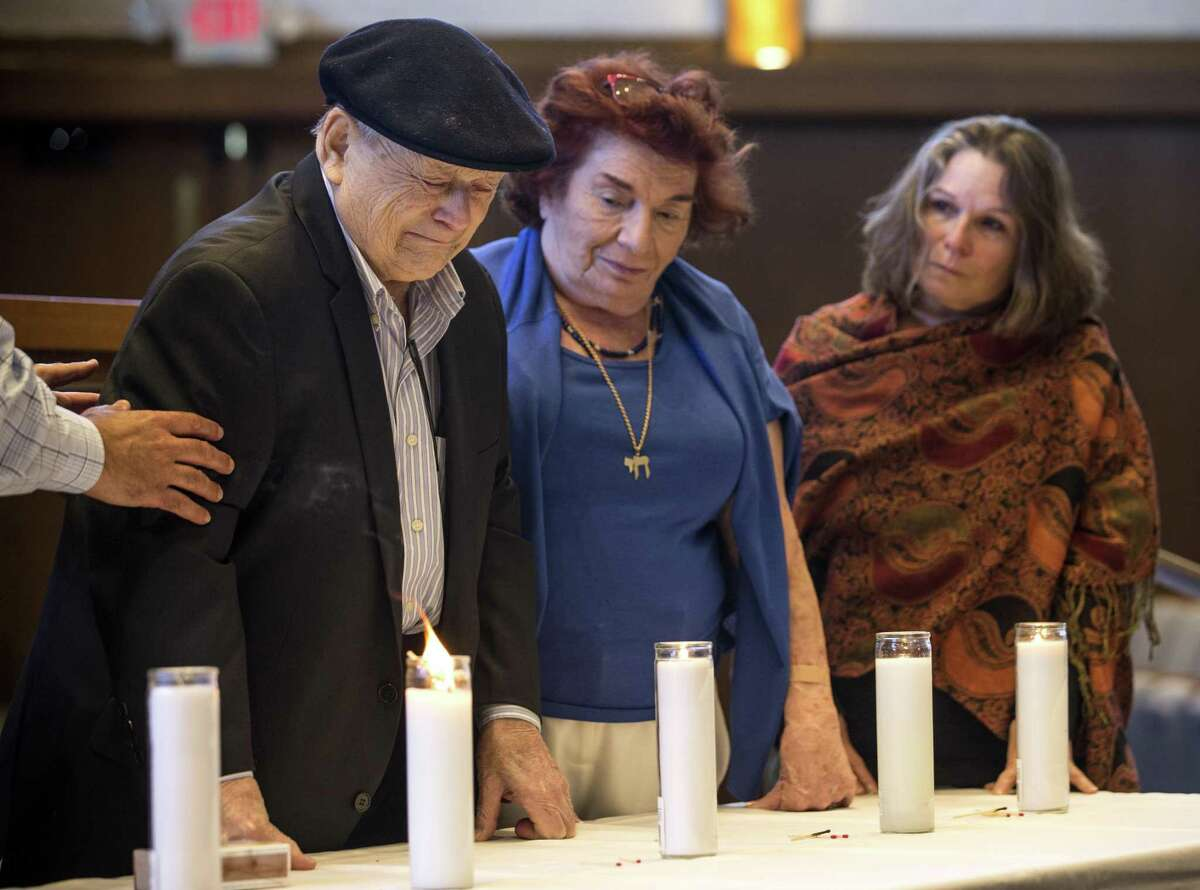 Holocaust survivors Erwin and Monique Ritter pause after lighting a candle during the Citywide Yom HaShoah Observance at Congregation Emanu El on Sunday, April 15, 2018, in Houston. Yom HaShoah is a day of remembrance of the 6 million Jewish people who lost their lives during the Holocaust. The ceremony also honors those who survived, coming together to remember and reflict., ( Brett Coomer / Houston Chronicle )