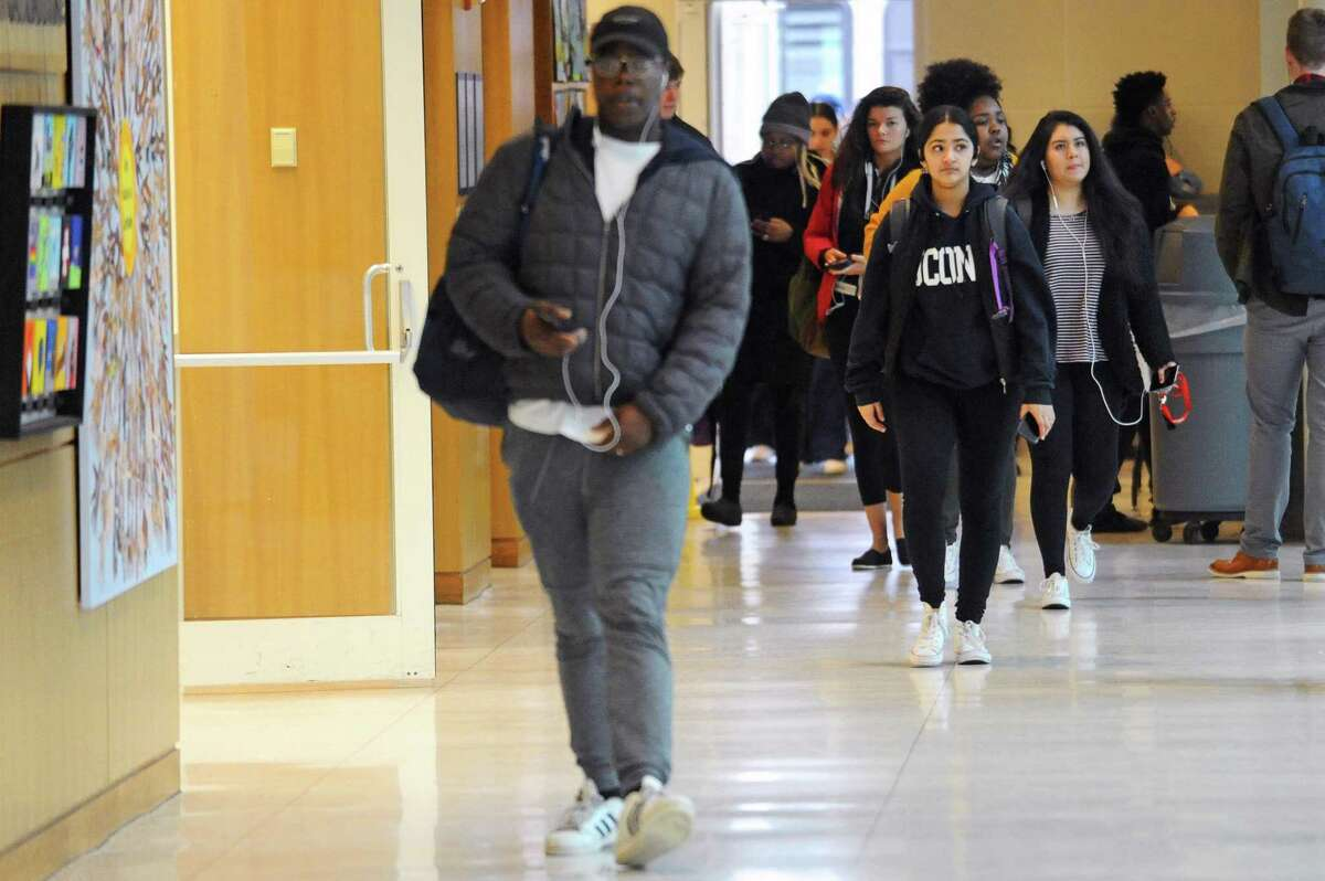 Students walk through the concourse in the main building of the University of Connecticut's campus, at 1 University Place, in downtown Stamford, Conn., on Wednesday, April 5, 2018.