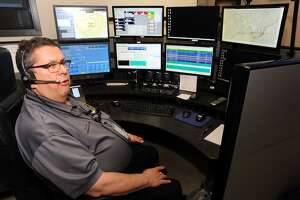 Dispatcher John Butz in the Emergency Dispatch Center at Trumbull Police Headquarters.