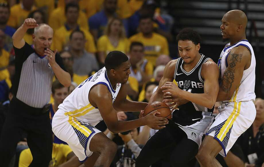 Golden State Warriors' Kevon Looney, left, steals the ball during the second half in Game 1 of a first-round NBA basketball playoff series against the San Antonio Spurs Saturday, April 14, 2018, in Oakland, Calif. (AP Photo/Ben Margot) Photo: Ben Margot / Associated Press