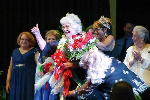 Betty O'Bannon gives a thumbs up after being crowned the 2018 winner during the Ms. Pasadena Senior Pageant.